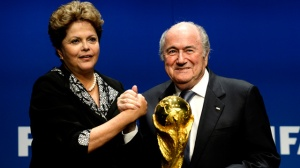 FIFA President Joseph Sepp Blatter, right, poses with Dilma Rousseff, President of Brazil, left